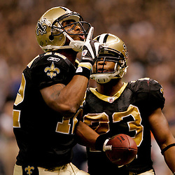 2009 November 30: New Orleans Saints wide receiver Marques Colston (12) celebrates with teammate running back Pierre Thomas (23) after scoring a touchdow during a 38-17 win by the New Orleans Saints over the New England Patriots at the Louisiana Superdome in New Orleans, Louisiana.
