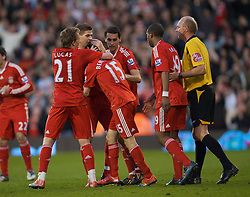 LONDON, ENGLAND - Saturday, April 4, 2009: Liverpool's match-winner Yossi Benayoun (hidden) is mobbed as he celebrates his goal with team-mates against Fulham during the Premiership match at Craven Cottage. (Pic by David Rawcliffe/Propaganda)