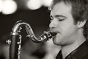 Dean Nixon on a Selmer Bass Clarinet with the Tom Richards Orchestra at the Friday Tonic concert in 2008. In black and white. Frontroom, Queen Elizabeth Hall, Southbank Centre, London