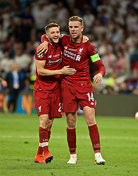 MADRID, SPAIN - SATURDAY, JUNE 1, 2019: Liverpool's captain Jordan Henderson (R) and Adam Lallana celebrate emotionally after the UEFA Champions League Final match between Tottenham Hotspur FC and Liverpool FC at the Estadio Metropolitano. Liverpool won 2-0 to win their sixth European Cup. (Pic by David Rawcliffe/Propaganda)