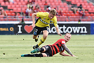 February 12, 2017: Central Coast Mariners forward Trent BUHAGIAR (12) tackled by Western Sydney Wanderers defender Jack CLISBY (3) at Round 19 of the 2017 Hyundai A-League match, between Western Sydney Wanderers and Central Coast Mariners played at Spotless Stadium in Sydney.