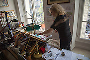 "March 6, 2015, Paris, France. Writer Maryse Wolinski (1943, Algiers) in Georges Wolinski's artist studio in the Paris' apartment where Georges and Maryse Wolinski used to live. Two month after the death of Georges Wolinski (1934 –2015), the apartment is full of souvenirs. <br /> In 2016 Maryse Wolinski published the book ""Chérie, je vais à Charlie"" about her husband and the attack on Charlie Hebdo. The cartoonist Georges Wolinski was 80 years old when he was murdered by the French jihadists Chérif en Saïd Kouachi, he was one of the 12 victims of the massacre in the Charlie Hebdo offices on January 7, 2015 in Paris. Charlie Hebdo published caricatures of Mohammed, considered blasphemous by some Muslims. During his life, Georges Wolinski defended freedom, secularism and humour and was one of the major political cartoonists in France. The couple was married and had lived for 47 years together. Photo: Steven Wassenaar."