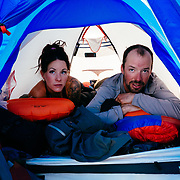 Shannon and Andy Mahre sit in their tent hiding from the sun.