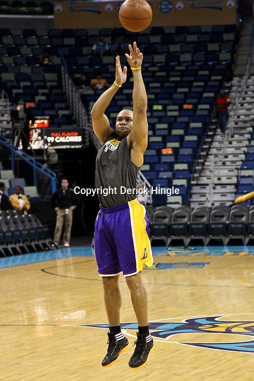 April 24, 2011; New Orleans, LA, USA; Los Angeles Lakers point guard Derek Fisher (2) prior to tip of game four of the first round of the 2011 NBA playoffs against the New Orleans Hornets at the New Orleans Arena.    Mandatory Credit: Derick E. Hingle