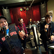 """December 5, 2013 - New York, NY: The cast of the NBC musical drama television series """"Smash"""" including, foreground from left, Jeremy Jordan and Andy Mientus, rehearse at Smash Studios at 36th Street in Manhattan on Thursday afternoon in preparation for their cabaret performance of """"HIT LIST,"""" which will premiere Sun, Dec 8 at 54 Below. Also pictured, in background from left, are Jennifer Ashley Tepper (director of programming for 54 Below), Benjamin Rauhala (pianist), Shannon Ford (drums), and Charlie Rosen (guitar). CREDIT: Karsten Moran for The New York Times"""