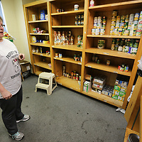 Susan Gilbert, Social Services Program Coordinator for the Salvation Army in Tupelo, gets a count of the number of empty shelves inside the food pantry Wednesda morning at the Salvation Army.