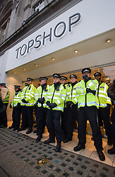 © under license to London News Pictures. 29/01/2011. Police prevent student demonstrators from entering a Topshop store on Oxford Street, London during more student demonstrations today (29/01/2011). Thousands of students took to the streets of London and Manchester to protest against cuts to education. Photo credit should read: London News Pictures