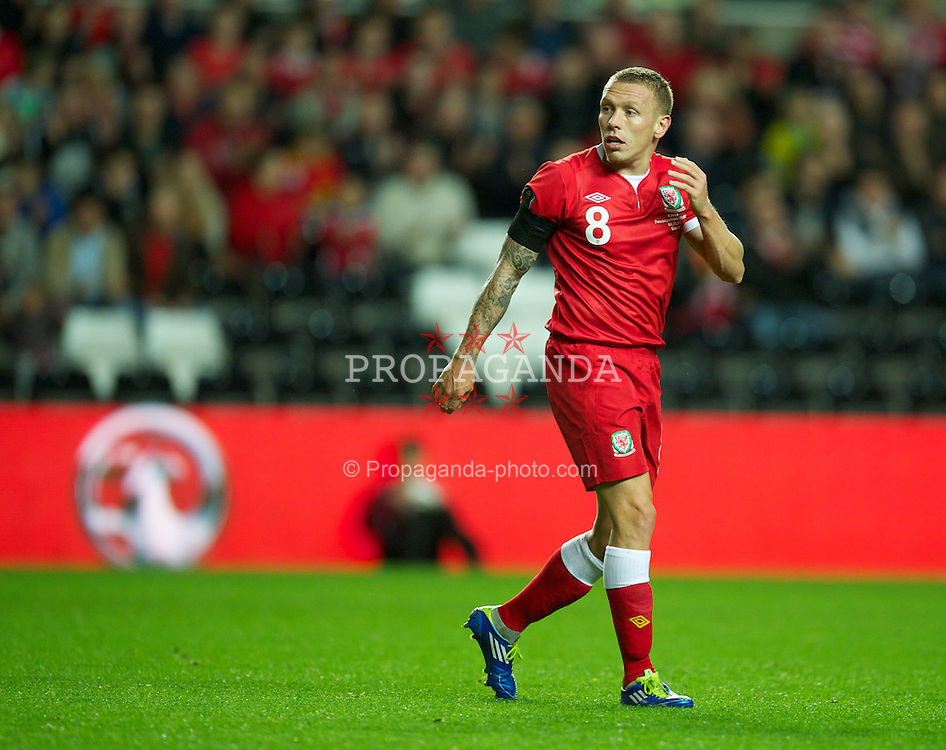 SWANSEA, WALES - Friday, October 7, 2011: Wales' Craig Bellamy in action against Switzerland during the UEFA Euro 2012 Qualifying Group G match at the Liberty Stadium. (Pic by David Rawcliffe/Propaganda)