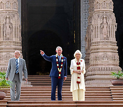 60690593  <br /> The British royal couple, Prince Charles (C) and his wife Camilla Parker Bowles (R), pose for photos in front of the Akshardham temple in New Delhi, India, Nov. 8, 2013. The British royal couple, Prince Charles and his wife Camilla Parker Bowles, arrived in Dehradun, northern India Wednesday to start a nine-day tour of India, reported Press Trust of India, Friday, 8th November 2013. Picture by  imago / i-Images<br /> UK ONLY