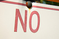Tight shot of the word no on a street sign.