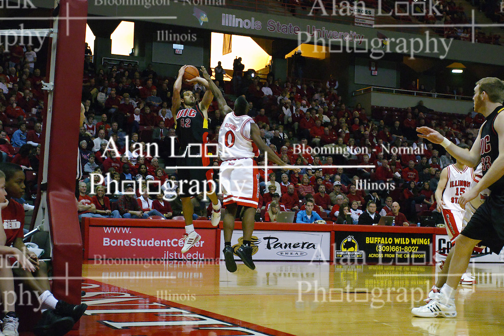 20 December 2008: Osiris Eldridge challenges a shot by Tori Boyd during a game where the  Illinois State University Redbirds go to 11-0 on the season defeating the Flames of Illinois Chicago by a score of 67-60 on Doug Collins Court inside Redbird Arena on the campus of Illinois State University in Normal Illinois.