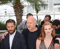 Tom Hardy, John Hillcoat, Jessica Chastain, at the Lawless film photocall at the 65th Cannes Film Festival. The screenplay for the film Lawless was written by Nick Cave and Directed by John Hillcoat. Saturday 19th May 2012 in Cannes Film Festival, France.
