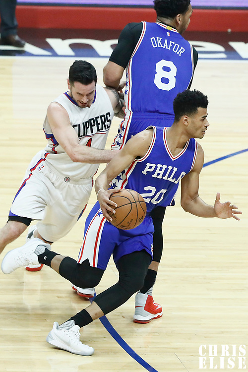11 March 2017: Philadelphia 76ers guard Timothe Luwawu-Cabarrot (20) drives past LA Clippers guard J.J. Redick (4) on a screen set by Philadelphia 76ers center Jahlil Okafor (8) during the LA Clippers 112-100 victory over the Philadelphia Sixers, at the Staples Center, Los Angeles, California, USA.
