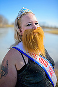 "Loralen Morgan of Athens, Ohio, dons a bearded lady costume to match the circus theme that the Power 105 ""Sub Zero Heroes"" fundraising group decided to commit to during their dives at the sixth-annual Polar Bear Plunge at Lake Snowden in Albany, Ohio, Saturday, Feburary 9, 2013."
