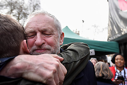 "© Licensed to London News Pictures. 04/03/2017. London, UK. Jeremy Corbyn, Labour leader, hugs a young fan ahead of addressing thousands taking part in a ""Save the NHS"" rally.  The demonstrators marched from Tavistock Square to Parliament Square protesting against funding cuts. Photo credit : Stephen Chung/LNP"
