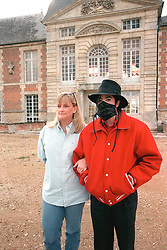 File photo dated July 1997 of 'King of Pop' Michael Jackson with his wife Debbie Rowe, visiting the 'Champ de Bataille' castle in French Normandie. Rowe just announced that she was then paid more than 5 millions dollars to marry Michael Jackson and give him the children she carried... Photo by Balkis Press/ABACAPRESS.COM  | 92381_02