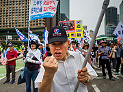 09 JUNE 2018 - SEOUL, SOUTH KOREA: A South Korean man who supports a strong stand against Kim Jong-un marches in a pro-American rally in downtown Seoul. Participants said they wanted to thank the US for supporting South Korea and they hope the US will continue to support South Korea. Many were also opposed to ongoing negotiations with North Korea because they don't think Kim Jong-un can be trusted to denuclearize or to not attack South Korea.     PHOTO BY JACK KURTZ