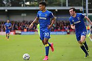 AFC Wimbledon striker Lyle Taylor (33) dribbling with AFC Wimbledon defender Sean Kelly (22) on the overlap during the EFL Sky Bet League 1 match between AFC Wimbledon and Peterborough United at the Cherry Red Records Stadium, Kingston, England on 17 April 2017. Photo by Matthew Redman.