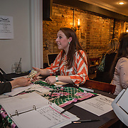 WASHINGTON,DC - MAR20: Margaret Johnson, a Sweet Briar College alumna, sells drink tickets at a pop-up fundraiser at Mission in Dupont Circle, to save the womens' college in Virginia, which will close if it can't raise $250 million dollars, March 20, 2015. (Photo by Evelyn Hockstein/For The Washington Post)
