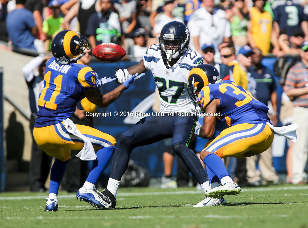 Seattle Seahawks cornerback Neiko Thorpe (27) is defended by Los Angeles Rams wide receiver Tavon Austin (11) and cornerback Troy Hill (32) during a NFL football game, Sunday, Sept. 18, 2016, in Los Angeles. The Rams won 9-3. (Photo by Ringo Chiu/PHOTOFORMULA.com)<br /> <br /> Usage Notes: This content is intended for editorial use only. For other uses, additional clearances may be required.