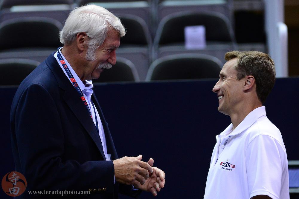 June 29, 2012; San Jose, CA, USA; Bela Karolyi (left) talks to Valeri Liukin (right) during the 2012 USA Gymnastics Olympic Team Trials at HP Pavilion.