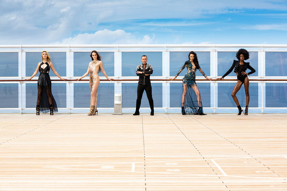 Models wearing classic designs by award winning fashion designer Julien Macdonald (centre) pictured on board Cunard's Queen Mary 2 during the Transatlantic Fashion Week.<br />