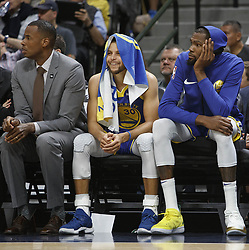 October 21, 2018 - Denver, Colorado, U.S - Warriors STEPHEN CURRY, center, and team mate KEVIN DURANT, right, look on from the bench during the 1st. Half at the Pepsi Center Sunday night. The Nuggets beat the Warriors 100-98. (Credit Image: © Hector Acevedo/ZUMA Wire)