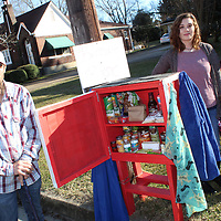 From left, David, Elisha, Emerie and Kenna Morris stand around the blessing box in their yard. The family has been helping the local homeless population.