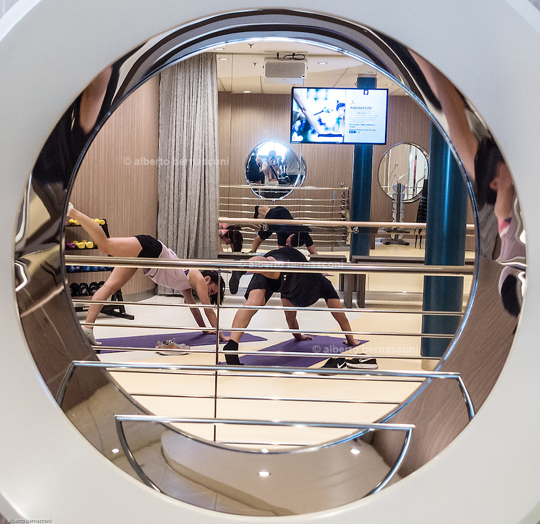 Royal Caribbean, Harmony of the Seas, The Fitness Center offers vacationers a plentiful and varied selection of exercise machines including the latest cardio and resistance equipment for working out alone or for joining one of the several classes, such as spinning, kickboxing, Pilates and yoga and a 4and a half kilometers running slope