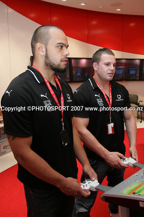 Sam Rapira (L) and Michael Crockett (R). Vodafone Warriors McLaren Mercedes F1 Simulator event. Vodafone New Zealand, Auckland. Thursday 23 August 2007. Photo: Hagen Hopkins/PHOTOSPORT