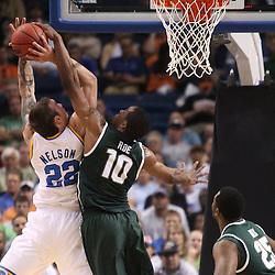 Mar 17, 2011; Tampa, FL, USA; Michigan State Spartans forward Delvon Roe (10) blocks a shot by UCLA Bruins forward Reeves Nelson (22) during the first half of the second round of the 2011 NCAA men's basketball tournament at the St. Pete Times Forum.  Mandatory Credit: Derick E. Hingle