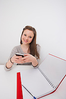 Portrait of businesswoman using cell phone in office