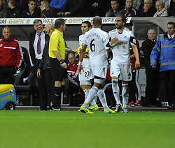 West Ham United Manager, Sam Allardyce and Swansea City's Chico don't see eye to eye - Photo mandatory by-line: Joe Meredith/JMP - Tel: Mobile: 07966 386802 27/10/2013 - SPORT - FOOTBALL - Liberty Stadium - Swansea - Swansea City v West Ham United - Barclays Premier League