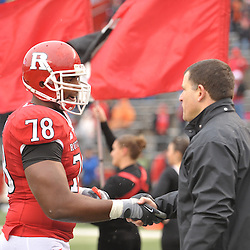 Dec 5, 2009; Piscataway, NJ, USA; Rutgers head coach Greg Schiano shakes hands with offensive lineman Kevin Haslam during the senior ceremony before first half NCAA Big East college football action between Rutgers and West Virginia at Rutgers Stadium.