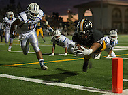 Foothill's Dezmond Hodges leaps across the goal line for a touchdown during Friday's game against Fountain Valley.