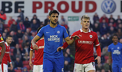 Ryan Tafazolli of Peterborough United is marked by Cameron McGeehan of Barnsley - Mandatory by-line: Joe Dent/JMP - 26/12/2018 - FOOTBALL - Oakwell Stadium - Barnsley, England - Barnsley v Peterborough United - Sky Bet League One