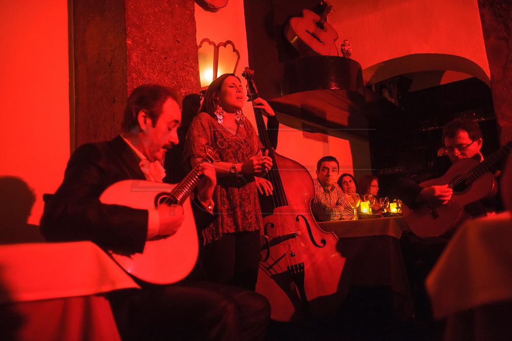 "Fado singerCristiana  at ""Clube de Fado"" restaurant. Fado was classified by UNESCO as Untangible World Heritage in November 2011."