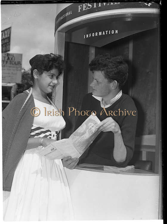 17/06/1960<br /> 06/17/1960<br /> 17 June 1960 <br /> Music Festival Kiosk. Picture shows Mrs Margaret Zaidan, Freetown, Sierra Leone, on honeymoon in Ireland, choosing festival events she wishes to attend ably assisted by Brian Mac Guigan at the Dublin International Festival of Music and the Arts Kiosk on College Street, Dublin.