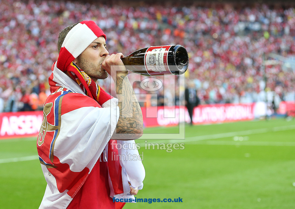 Jack Wilshere of Arsenal celebrates after the The FA Cup Final match at Wembley Stadium, London<br /> Picture by Paul Terry/Focus Images Ltd +44 7545 642257<br /> 17/05/2014