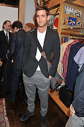 OLIVER JACKSON-COHEN at the opening of the new Jack Spade store at 83 Brewer street, London on 29th March 2012.
