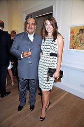 HIS HIGHNESS MAHARAJA GAJ SINGH I I OF MARWAR- JODHPUR and LIZ HURLEY  at a party to launch the Indian Head Injury Foundation held at Thomas Gibson Fine Art Ltd. 31 Bruton Street, London on 16th June 2009