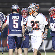 Drew Snider #23 of the Denver Outlaws walks away from members of the Boston Cannons during the game at Harvard Stadium on May 10, 2014 in Boston, Massachusetts. (Photo by Elan Kawesch)