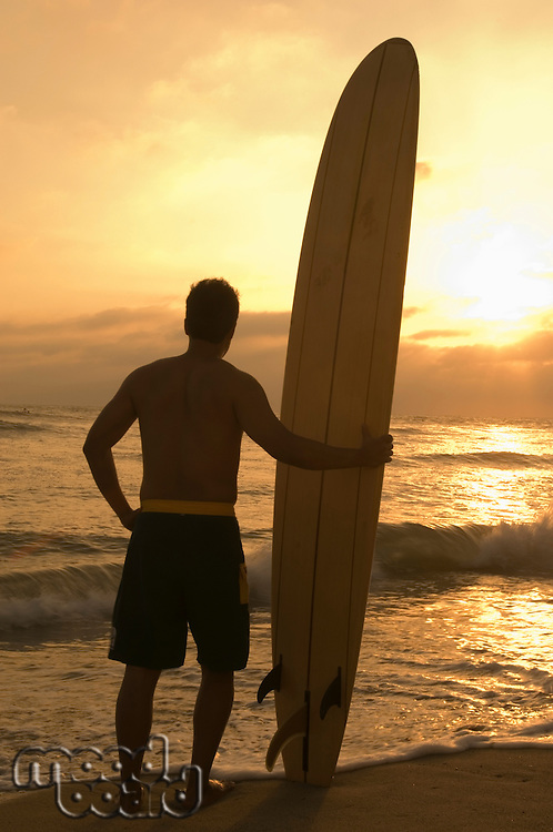 Longboard Surfer Enjoying Sunset on Beach