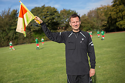 © Licensed to London News Pictures . 28/09/2014 . Birmingham , UK . Health Secretary JEREMY HUNT posing with his flag , serving as linesman during the match . Conservative Party vs Journalists football match at a Birmingham University football pitch , at the start of the conference . The 2014 Conservative Party Conference in Birmingham . Photo credit : Joel Goodman/LNP
