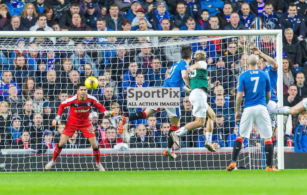 Jason Cummings has a header during the match between Rangers and Hibernian (c) ROSS EAGLESHAM | Sportpix.co.uk