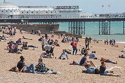 © Licensed to London News Pictures. 04/06/2017. Brighton, UK. Members of the public enjoy the sunny weather by spending the Sunday afternoon on the beach in Brighton and Hove. Photo credit: Hugo Michiels/LNP