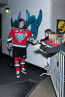 KELOWNA, CANADA - MARCH 18: Colten Martin #8 of Kelowna Rockets high fives little fans on his way to the dressing room on March 18, 2015 at Prospera Place in Kelowna, British Columbia, Canada.  (Photo by Marissa Baecker/Shoot the Breeze)  *** Local Caption *** Colten Martin; fans;