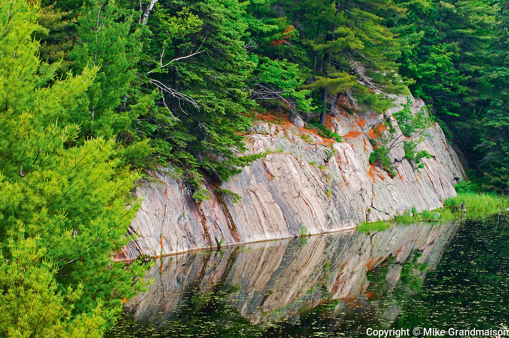 Granite reflected in wetland,<br /> Killarney District<br /> Ontario<br /> Canada