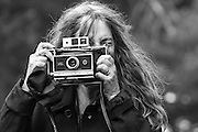 Patti Smith takes a photo of the crowd at San Francisco's Hardly Strictly Bluegrass Festival in Golden Gate Park