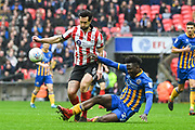 Scott Wharton of Lincoln City (6) and Aristote Nsiala of Shrewsbury Town (22) battle for the ball during the EFL Trophy Final match between Lincoln City and Shrewsbury Town at Wembley Stadium, London, England on 8 April 2018. Picture by Stephen Wright.